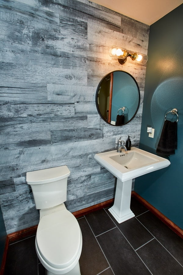Enkor barn wood wall planks in Classic Country used in rustic bathroom.