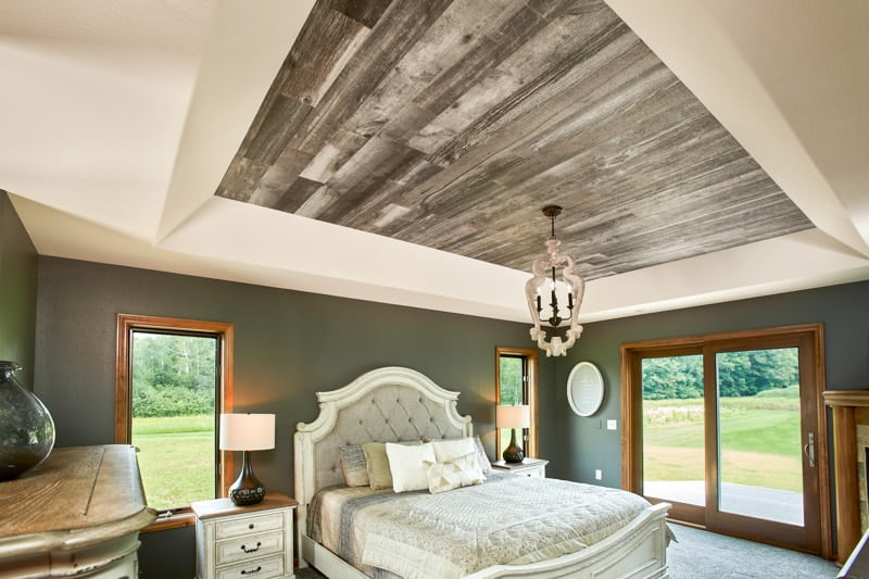 Enkor barn wood wall planks in Mountain Music used in rustic shabby chic bedroom.